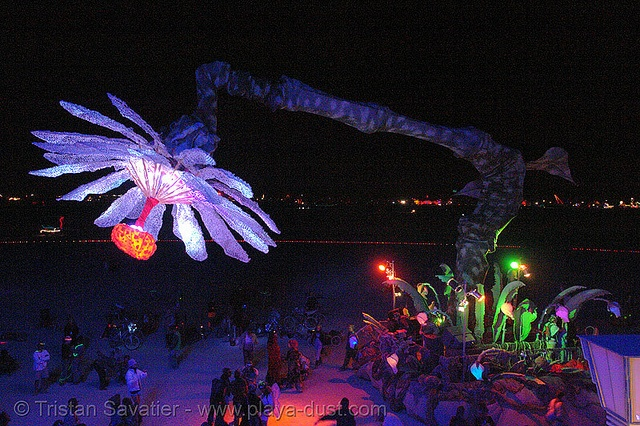 still my all time favorite Burning Man mutant vehicle- it's so great to dance in the desert under a giant flower!  the petals are adorned with white military style camo screen and it's made out of a giant tree digger upper thing- it even blooms!  it's so so cool
