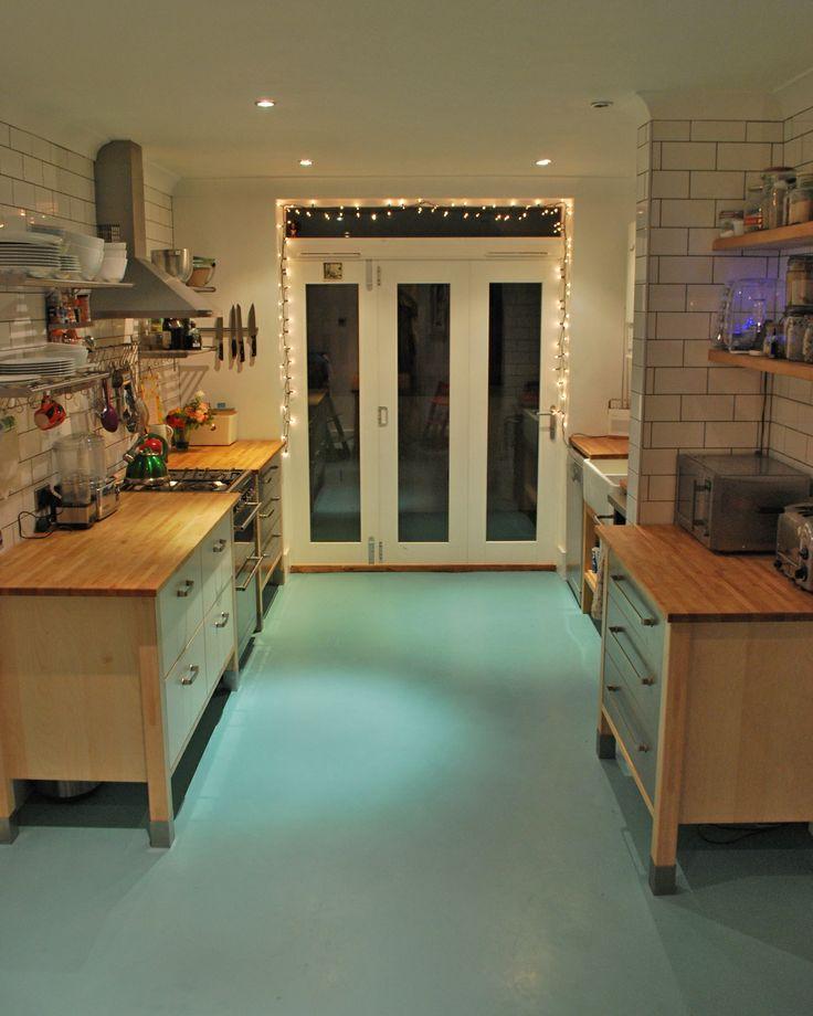 Poured resin floor RAL 6034, Ikea Varde units, Ikea Grundtal shelving, Metro tiles with grey grout, Wickes tri-fold doors, Belfast sink (hidden)