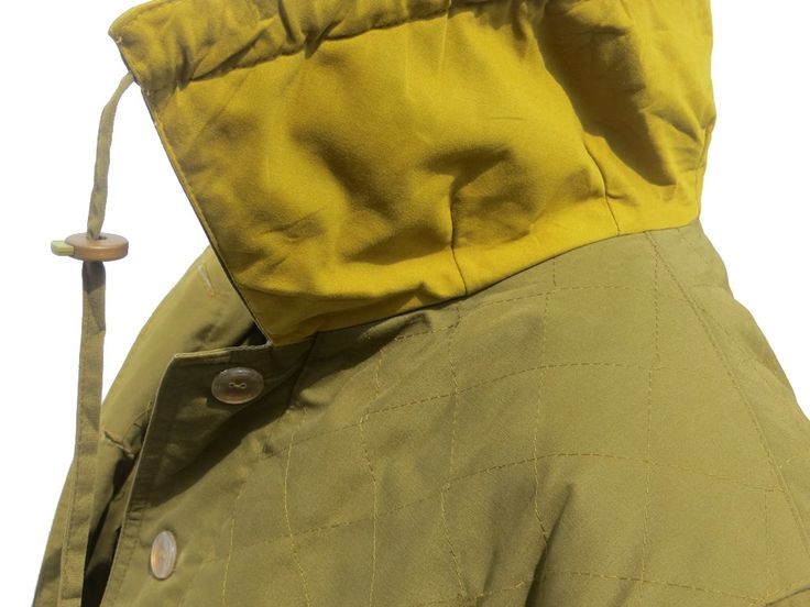 A quilted olive green coat from Marcona. An absolutely stunning silky lining,high collar and excellent finishes. An all weather sympayex fabric that is waterproof, a back flap, a back vent and two chest protector flaps.