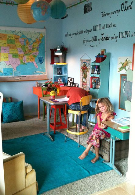 Color; map and globes; cubby station on wall; painted old-school desk