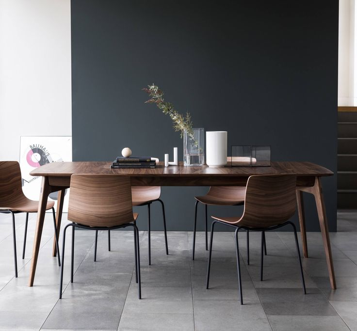 The Dulwich Dining Table is an elegant extending table designed by Matthew Hilton. The solid wood legs and under-frame supports the generous width top.