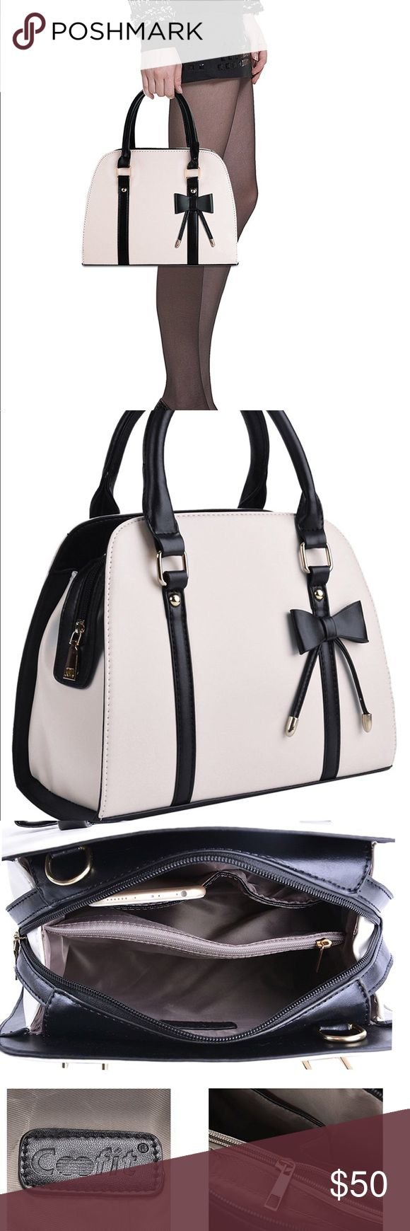 Cute Black & Cream Bow Purse Adorable and classy purse, very roomy and sturdy. Three pockets, 2 handles and an adjustable strap so that it can be worn like a Crossbody. Dimensions: 13.4 x 5.9 x 9.8. Smoke-free home. Quality faux-leather. Bags Shoulder Bags