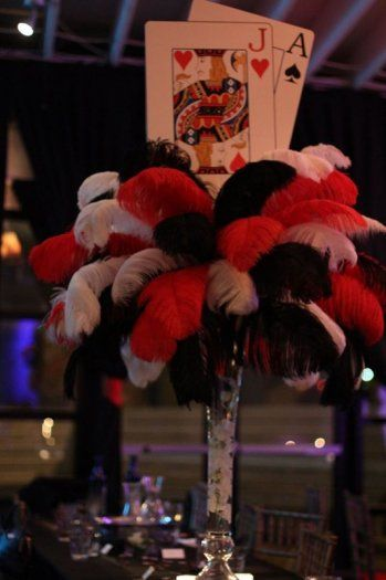 Ostrich feather & playing card Bar Mitzvah centerpieces to match a casino theme!
