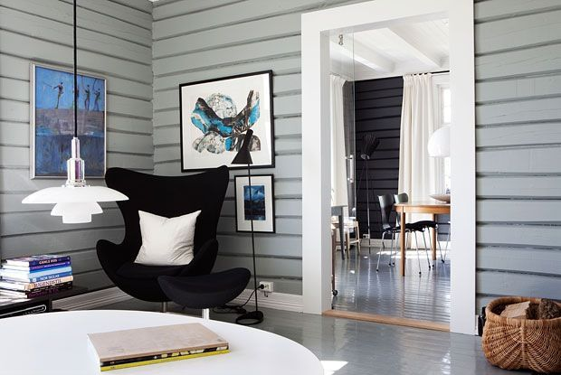 Source: The Diversion Project  Mid Century Modern meets modern day. The Egg chair, the Jacobsen floor lamp, glass pendant, the Series 7 chairs (in the back room…..) and the contemporary almost cottage-like style of architecture. Good mix.  You can find all those pieces here, here, here & here.