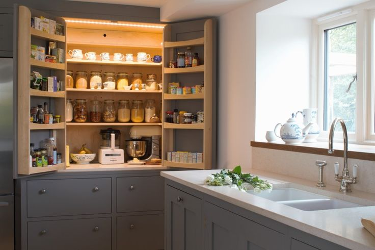 Sustainable Kitchens - A beautiful open plan barn conversion. An open LED lit larder cupboard with amble storage and efficient ventilation painted in Farrow & Ball moles breath. The bottom shelf is a cold shelf with built in wall ventilation with the drawers below also used as cold storage for vegetables. Bringing old traditions into a a modern kitchen. Adjacent the marble worktop provides a crisp and clean feel.
