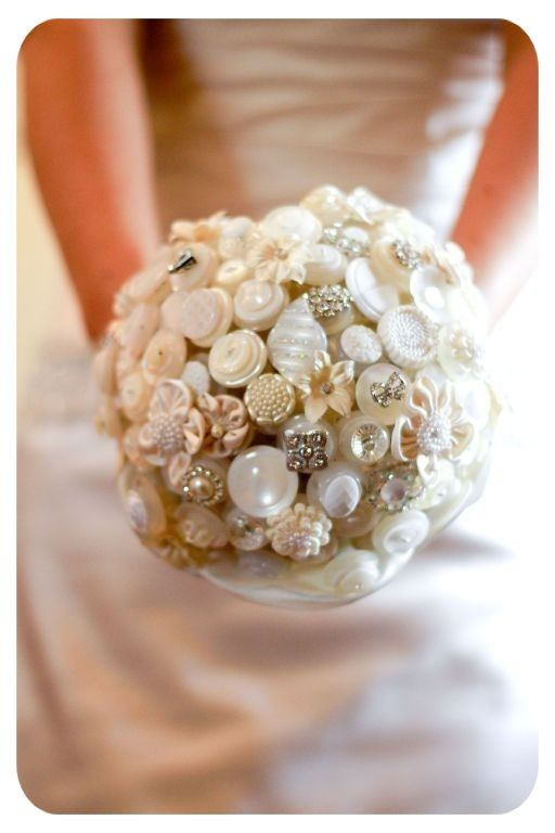 An alternative to a bridal floral bouquet.  antique jewelry, buttons, shells, silk flowers and lace.