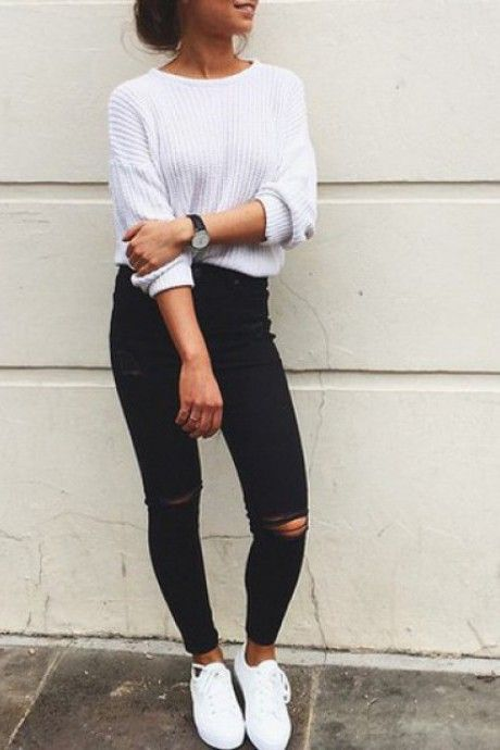 A cute white knitted jumper and pair of black jeans and some adidas  superstars triple white.