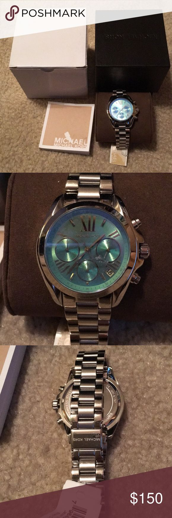 Michael Kors Emerald Face Watch New with tags and original inner and outer box and manual.  This was a gift for my girlfriend and she is not a watch person. It has a polished steel band with emerald colored face and gold roman numerals. Still has the plastic on it Michael Kors Accessories Watches