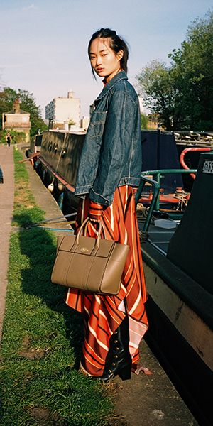 New Bayswater Bag in Clay, Victoria dress in Orange and the Marylebone Booties in Black at Mulberry.com.