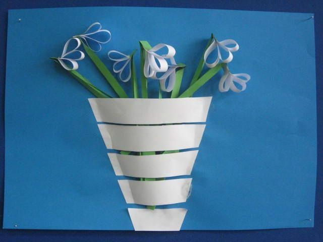Vase of flowers ** have kids  weave strips of paper through 2 precut slits in paper to form vase