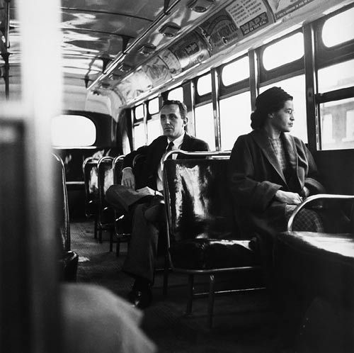 Rosa Parks (1913-2005) sits in the front of a bus in Montgomery, Ala., in 1956.