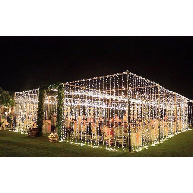 Temporary outside room created with fairy lights with floral or foliage entrance.  Perfect for an evening blessing.