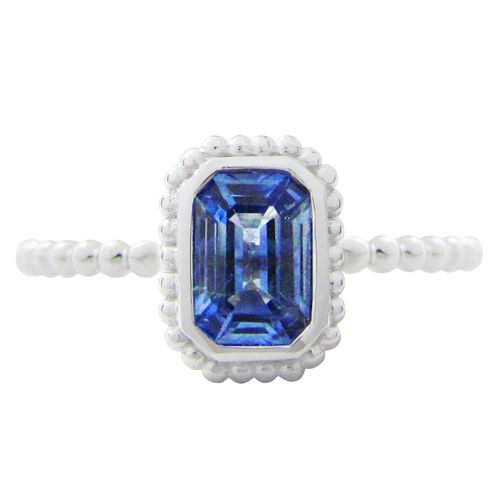 THE TESSA RING WITH BLUE SAPPHIRE  This lovely radiant cut blue sapphire weighs .65ct and is nestled in a 14 karat white gold granulated Tessa ring setting. This blue sapphire ring is a size 6 which can also be sized. (R657)