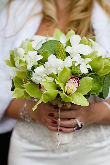 """Bridal bouquet made with green cymbidium, white dendrobium, lotus pods and star of Bethlehem. Created by Jennifer French of Lush Floral."""