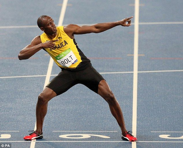 Bolt strikes his familiar 'lightning bolt' celebratory pose following victory in…
