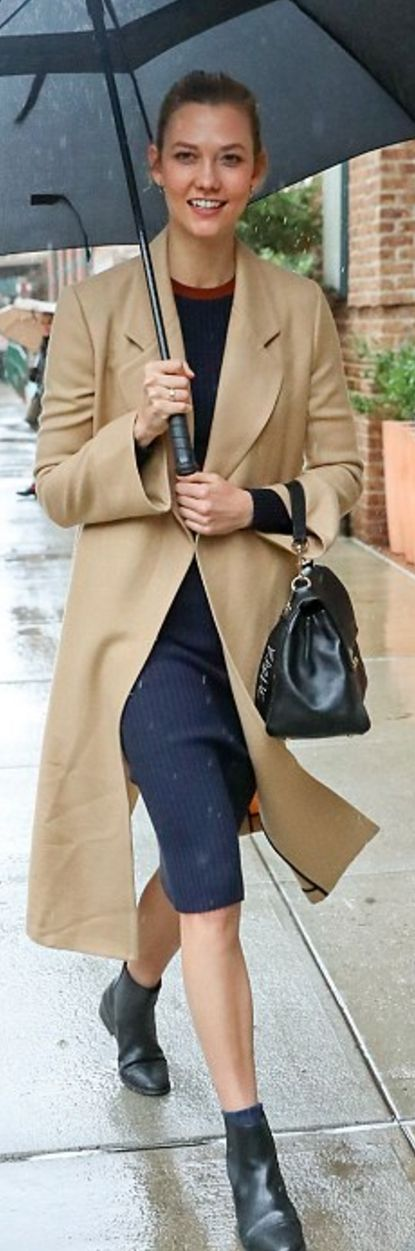 Who made Karlie Kloss' blue cut out dress, tan coat, and black handbag?