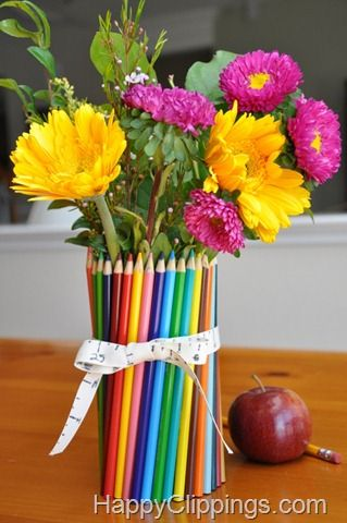 I made these vases for end of year teacher gifts last year. I bought simple straight vases for a dollar at the dollar store. Instead of just wrapping the pencil crayons with a ribbon, I hot glued them right on the vases. One I did in rainbow colours and one I did in random colours. They were a big hit, with lots of oooh and aaahs!