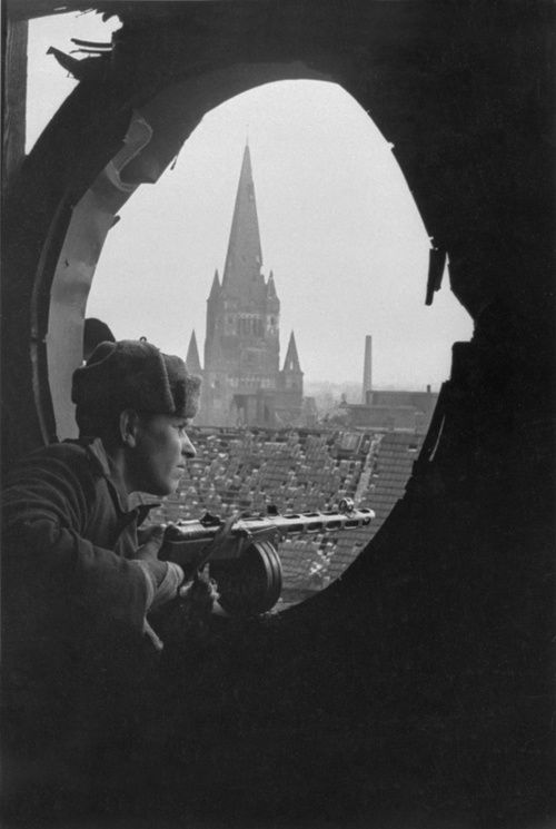 Some photos capture the intensity of war and the emotions that go with it ~ MWB - Red Army soldier inspects the quarters of the city of Breslau,1945.