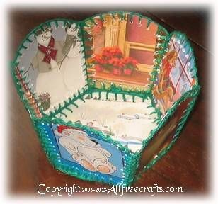 Learn how to make an hexagonal recycled greeting card basket, made from panels of old Christmas cards connected by yarn.  Template included.