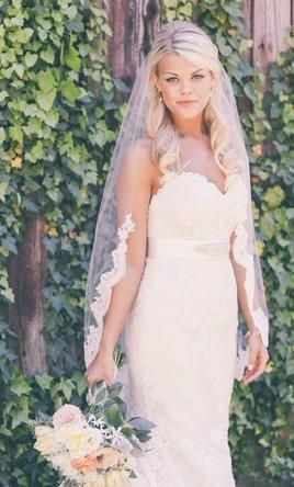 New With Tags/ Unaltered Ivory Veil: buy this dress for a fraction of the salon price on PreOwnedWeddingDresses.com