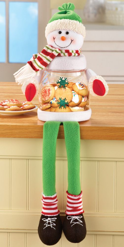 Christmas Treat Jar-Sitting Snowman Shelf Sitter Charming Sitting Snowman holds your favorite treats while also being an adorably festive decoration on a counter! http://kittykatkoutique.com/products-all/christmas-treat-jar-sitting-snowman-shelf-sitter/