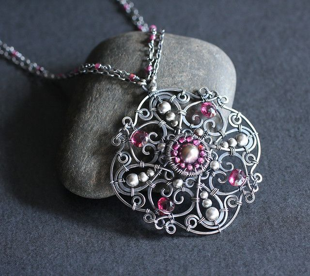 Another mandala in garnet, pearl and sterling silver. Quite a victorian feel to this one I think :)