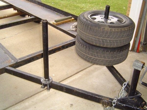 "Trailer Tire Rack by jpk -- Homemade tire rack for a car trailer fabricated from 1.5"" pipe and attached to a standard flange. Steel bars at the bottom of the frame secure the posts to the trailer. http://www.homemadetools.net/homemade-trailer-tire-rack-2"