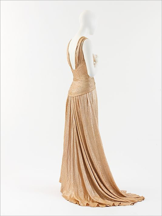 "Evening dress House of Chanel  (French, founded 1913) Designer: Gabrielle ""Coco"" Chanel (French, Saumur 1883–1971 Paris) Date: 1934 Culture: French Medium: silk, metal Gift of Mlle. Gabrielle Chanel, 1955"