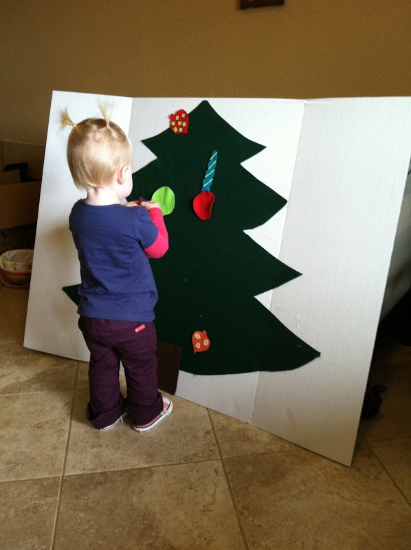 Toddler Christmas Tree - Let them decorate over and over again. Like that it's attached to a  tri fold For easy clean up and storage.