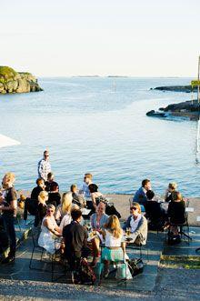 Sitting by the shore. Photo: Juho Kuva/Visit Finland Media Bank