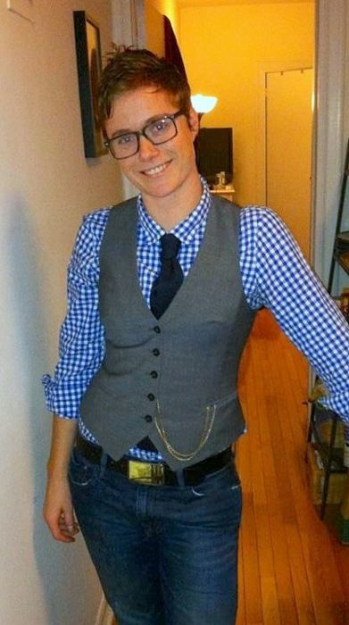 Checkered shirt, solid tie, vest overtop, and cute hair swag.