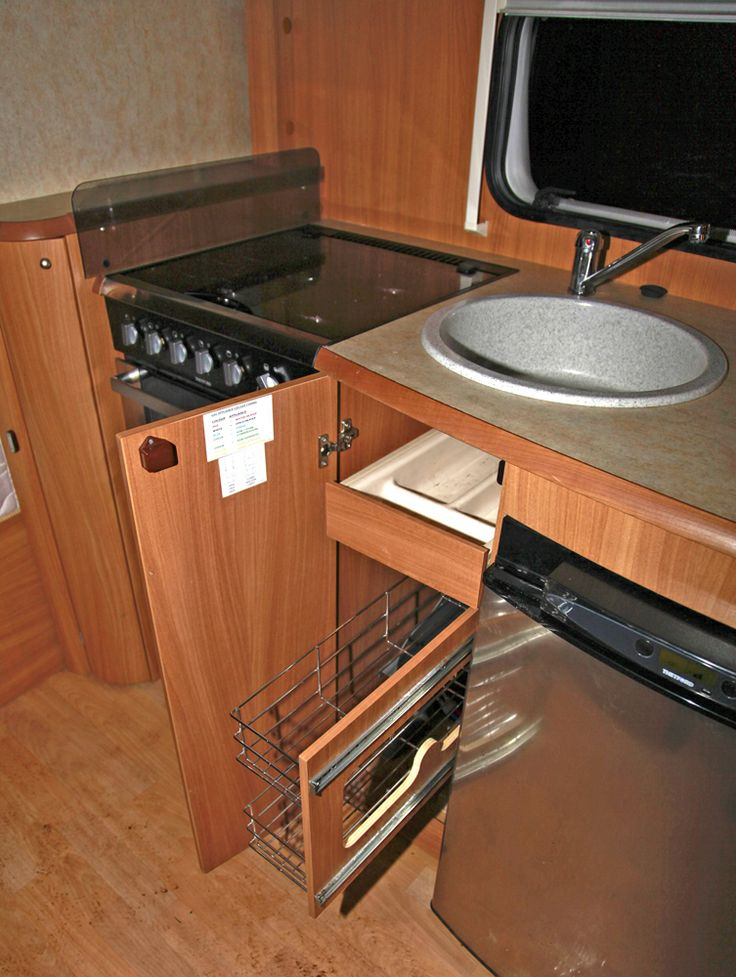 Pull out storage unit under kitchen sink swift challenger 625 twin axle caravan pinterest - Caravan kitchen sink ...