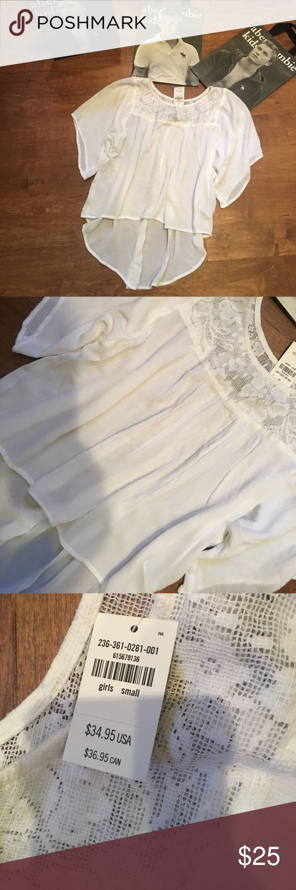 🤑SALE 👈NEW Abercrombie kids girls high-low NEW Abercrombie kids girls white high-low shirt with lace. Girls size Small 10 Retails for $34.95! This shirt is the cutest😀 Abercombie Kids Shirts & Tops Blouses