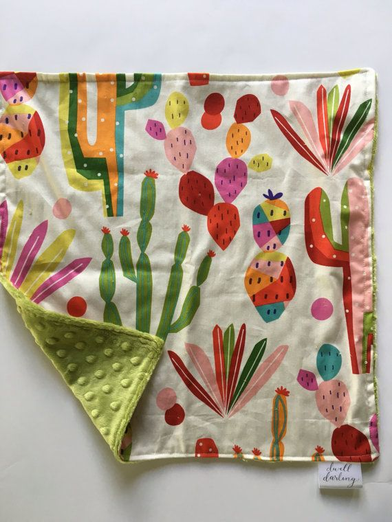 A fun cactus print in primary colors make up the front of this lovey. The back is a soft green minky. This little lovey will bring security to your little one and is the perfect size to be taken anywhere.  Measures approximately 15 inches x 15 inches.