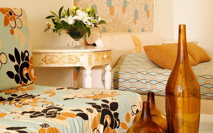 Kassandra Bay Hotel & Resort Junior Suite amenities. Double bed, Sofa, Bedside Table, Coffee Table. Visit www.kassandrabay.com/junior-suites-skiathos for more information.