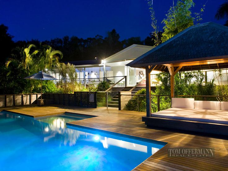 Deck with timber fencing, steps down into pool area at the side of the house.