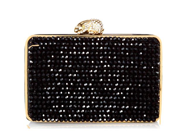 A sophisticated Flora Onyx box clutch bag from Wilbur & Gussie. This bag has been beautifully designed with black faceted-crystal beads hand-sewn on to the front and back. Bag has a crystal encrusted rabbit fastening, optional gold chain and a inner credit card pocket. View more bags from our Wilbur & Gussie Collection at: http://www.baroqueboutique.co.uk/wedding-shoes-and-accessories/