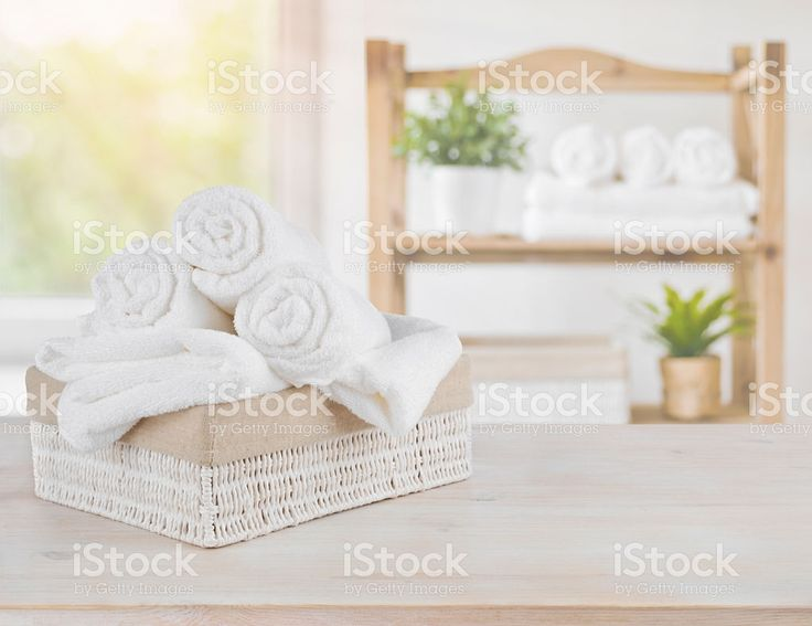 Spa towels on wood over abstract beauty salon room background royalty-free stock photo