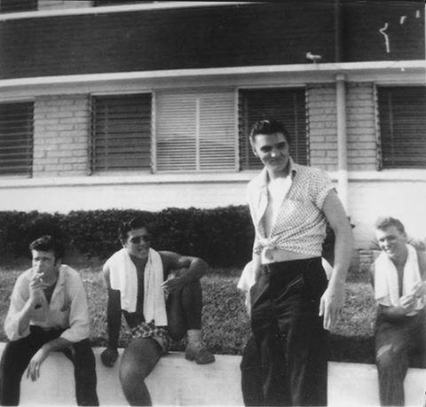 Elvis outside the Copacabana Motel - Daytona Beach in August 1956. Dude second from the left giving a 5 cent peep show. LOL