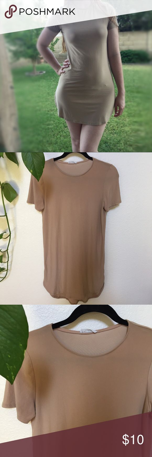 "Soft basic neutral tee dress Soft basic shirt dress/ tunic in a tan neutral shade. Fits more like a tunic on me because I'm so tall, but this would be a perfect basics dress for a shorter girl. 💖✨ a soft silky fabric & super comfy. My measurements are 5'8 and 32c, 28, 40"" for your reference. Nordstrom Dresses Mini"