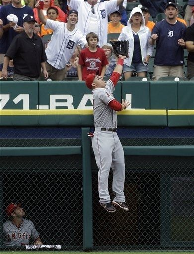 Game #93 7/19/12: Los Angeles Angels left fielder Mike Trout jumps but can't catch a two-run home run hit by Detroit Tigers' Alex Avila in the second inning of a baseball game in Detroit, Thursday, July 19, 2012. (AP Photo/Paul Sancya)Detroit Tigers, Ap Photos Paul, Angels Fans, Baseball Team, Anaheim Angels, Alex Avila, Los Angeles Angels, Baseball Games, Angels Baseball