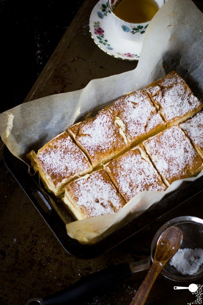 Karpatka: Polish Vanilla Custard Slice 125g unsalted butter, extra for greasing 1 cup plain flour 1 cup water 5 eggs For the vanilla custard cream: 750ml thick pouring vanilla custard 2 eggs 2 tbsp vanilla extract 4 tbsp plain flour 2 tbsp cornflour 300ml thickened cream To serve: icing sugar