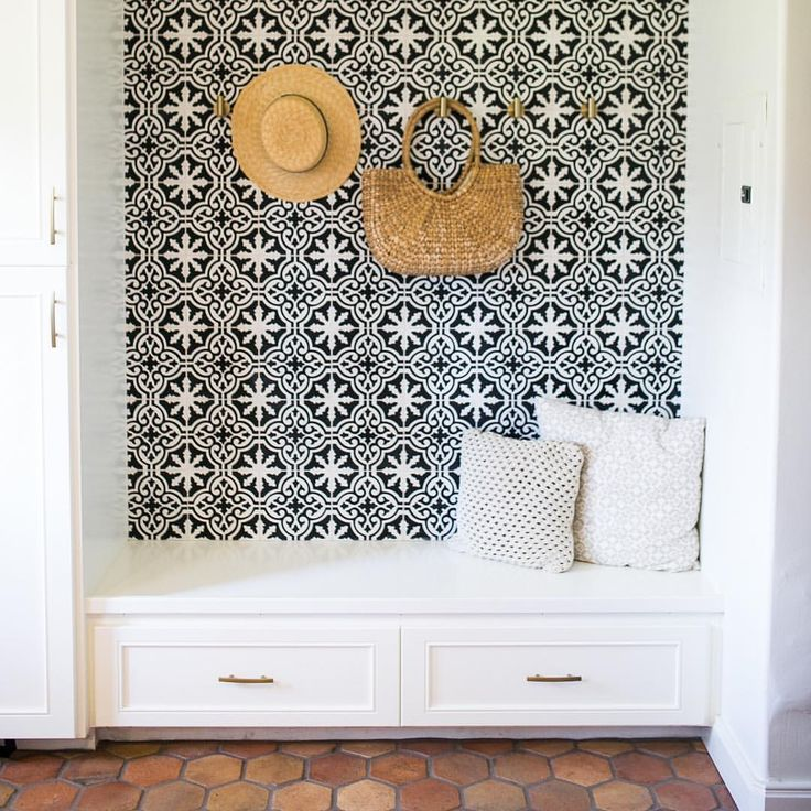 Saltillo tile floor + patterned cement tile on wall