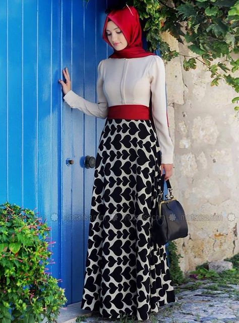 Black and white and red dress with a red hijab