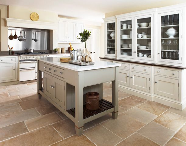 The mix of colours and cabinet configurations is beautiful for Traditional english kitchen
