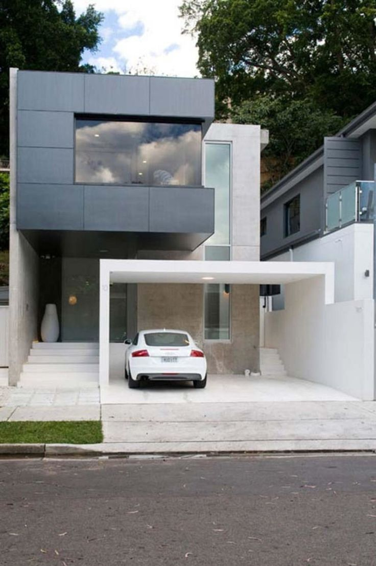 "Dislike: feels ""massive"" -- big masses.  That dark grey block we don't like. The carport, we don't like.  Home design, Minimalist House Architecture With Black Facade Design Color Equipped With Garage Design Outdoor: New minimalist house design w..."