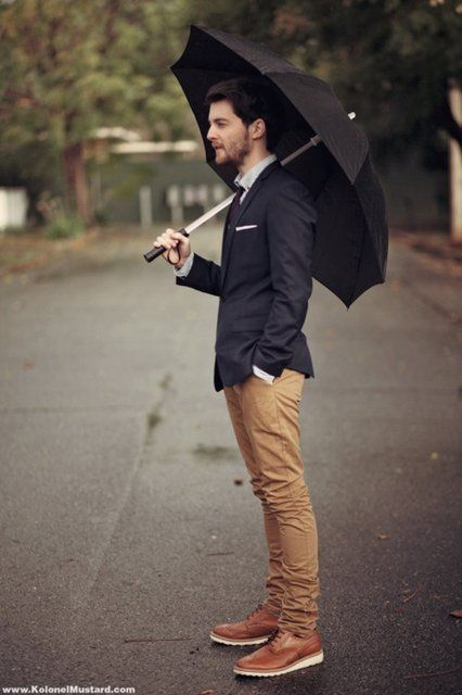 he's classy. AND carries a spiffy umbrella.