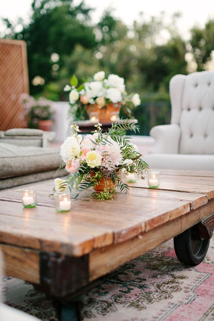 Absolutely love Found Vintage Rental's enfield wooden cart as the coffee table in this lounge vignette