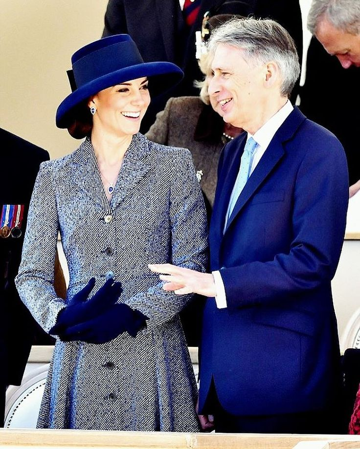 Her Royal Highness, The Duchess of Cambridge shares a laugh with the Chancellor of The Exchequer, Philip Hammond ahead of the Service of Dedication in recognition of those who served in the Afghanistan and Iraq wars, military or civilian, and those who supported them at home at Horse Guards Parade in London.