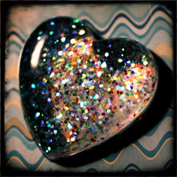 handmade clear resin heart with multicolored glitter
